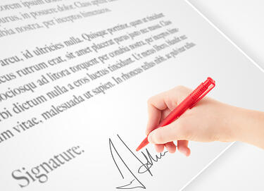 Hand writing personal signature on a legal paper-1